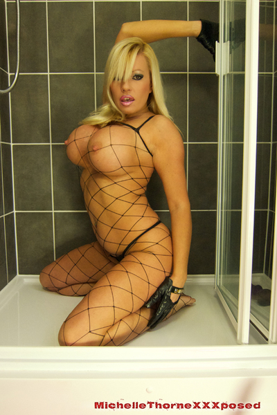 Blonde babe Michelle Thorne takes a hot shower-room in her tiny fishnet outfit and her kinky leather gloves. Afterward a bit of touching and teasing that babe pulls out her vast brown tool to have a bit of anal action!