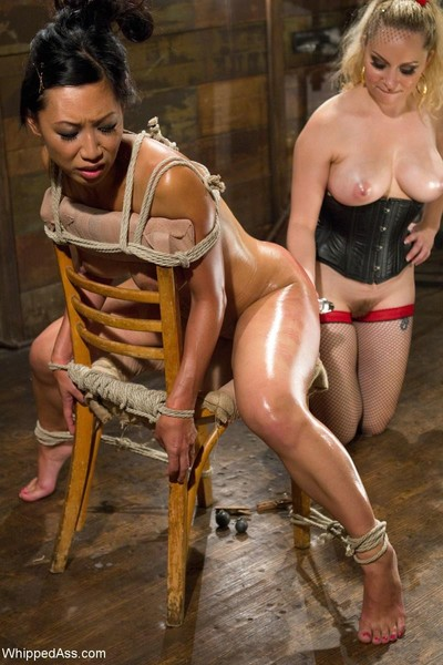 Sexy big titted asian babe gets tied up and fucked by lezdom