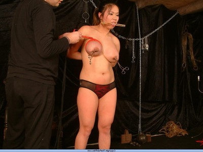 Rounded asian slavegirl in chest restriction and powerful tit torments