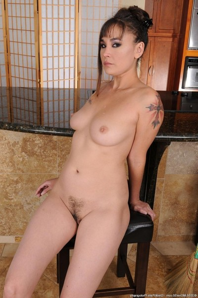 Damp wife removes clothes off her pajamas