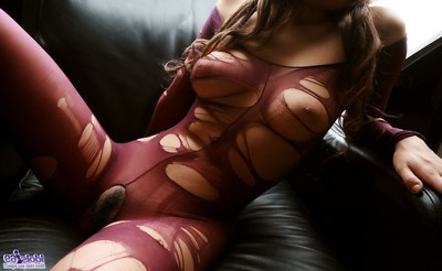 A willowy japanese woman in a fishnet body stocking