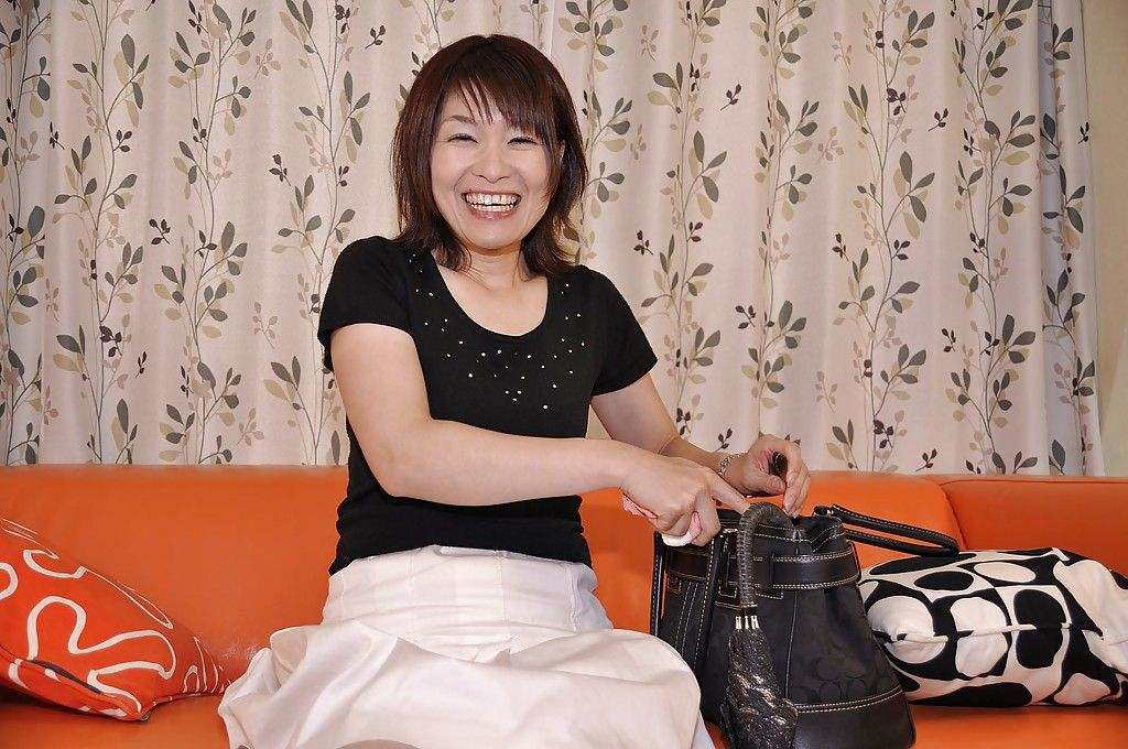 Smiley Japanese MILF Miki Ando lifts up her skirt and vibes her g-point