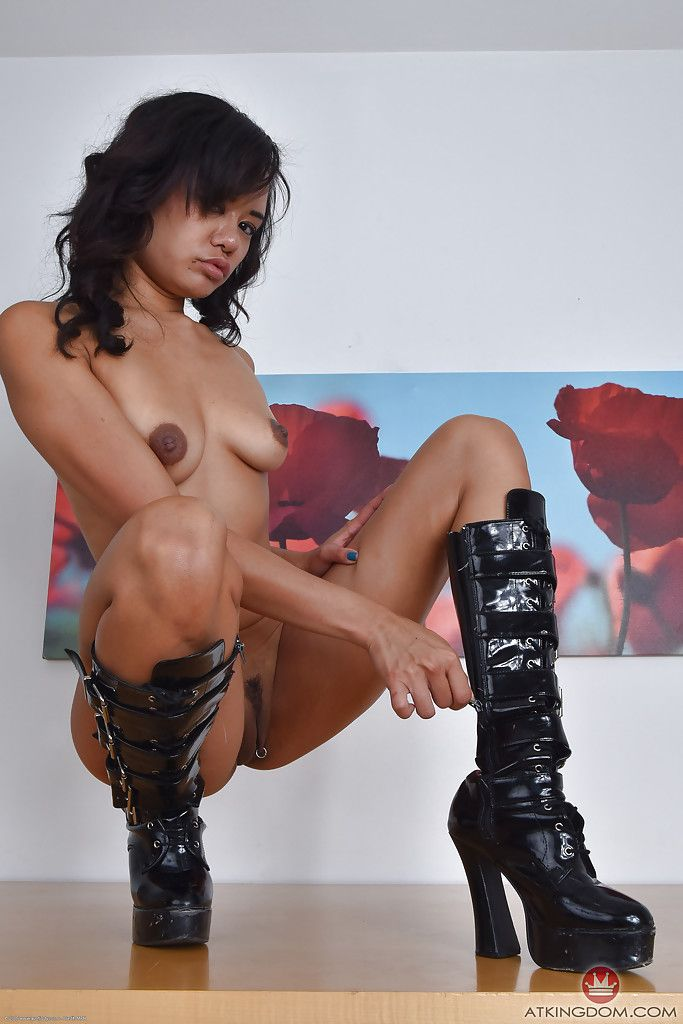 Japanese mom Annie Cruz strutting in latex clothing and knee high boots