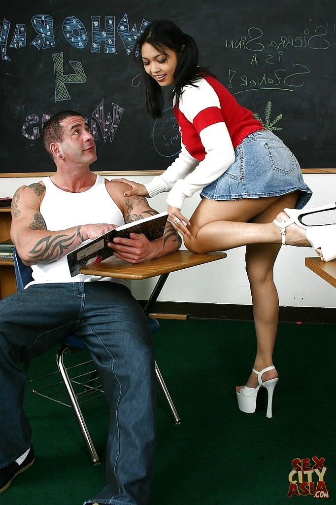 Adolescent Chinese milf Mika Tan enjoys hardcore anilingus in the classroom