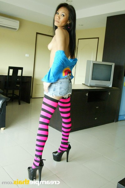 Pla undresses her pink and ebony striped nylons