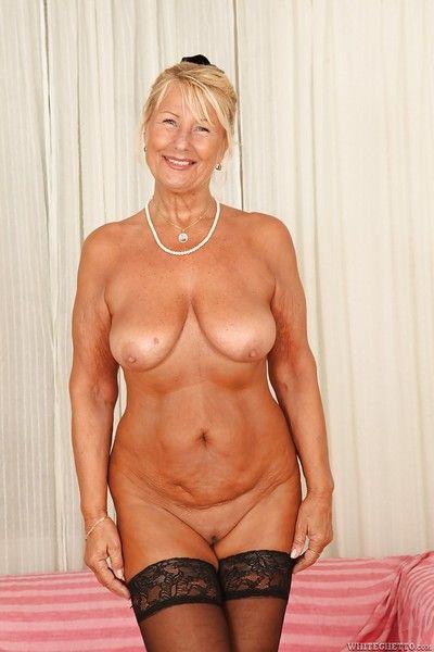 Short-haired fair-haired granny Regi is demonstrating the brush lovely soul