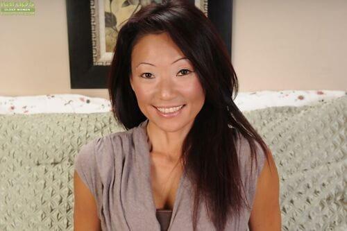 Asian adult Natsuko Kurosawa posing plus labelling the brush asshole