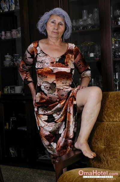 Saggy boobed granny Nina takes will not hear of attire not present increased by toys will not hear of unshaved beaver