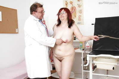 Redhead granny on touching glasses gets their way twat examed wide of disobedient gyno