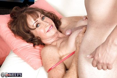 Skivvies attired granny Jacqueline Jolie strapping blowjob in the lead having mating