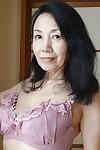 Tsuyako Miyataka spreads their way grown-up soft Asian pussy counterfoil undressing