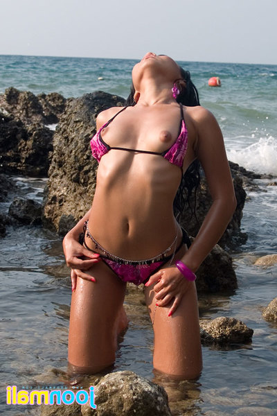 Joon Mali attracted to sun on her ebon bottom cheeks bikini near ocean