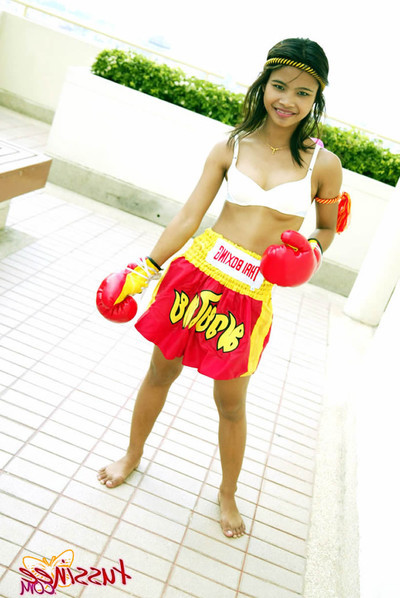 Bangkok youthful tussinee in a extreme muay thai boxing outfit