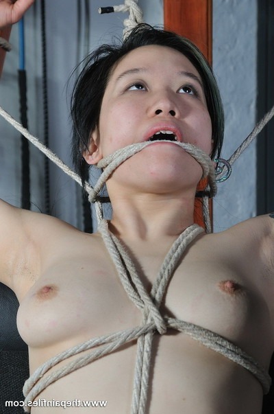 Sweet oriental adolescent in playroom rope slaving