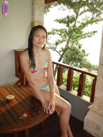 Marvelous oriental youthful model is posing outdoors