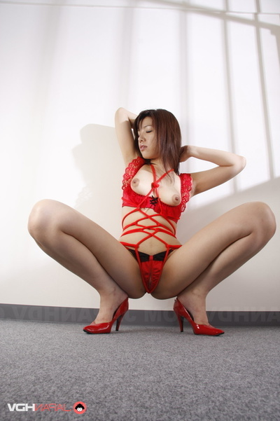 Angel Wrapped In Red Rope And Underware Posing Behind Bars.