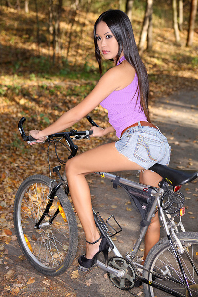 Beefy Japanese Floozy Rides A Bike And Standing Exposed On A Forest Road