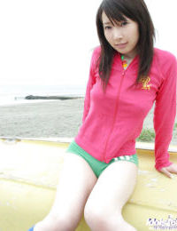 Slutty Chinese teen-age doll showcasing her vast knockers outdoor
