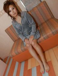 Oriental youthful Chisa Harihara getting undressed and playing with a toy dick
