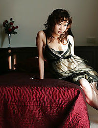 Pleasant Chinese cutie in  slipping off her clothing and lacy underware