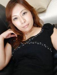 Japanese MILF Machiko Nishizaki undressing and exposing her inviting vagina
