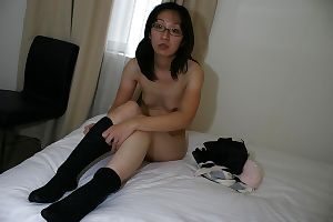 Lean Chinese MILF in glasses undressing and exposing her gentile in close up - part 2