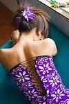 Lily Koh flashes white cotton underwear beneath a purple costume