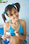 Slim Japanese Lily Koh pours milkshake on her young body