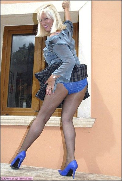 Spectacular blonde grown-up fatty shows gone her tight well-versed ears less sexy coal-black pantyhose.