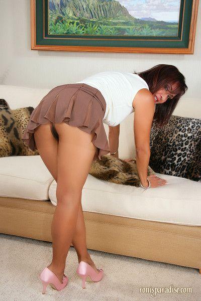 Grown up hottie Roni posing upskirt plus rubbing pussy through pantyhose