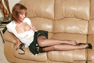 Mature redhead Roni reveals sexy breasts and licks her high heels