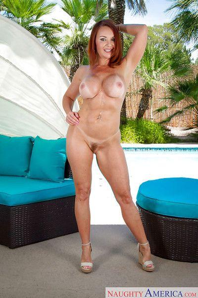 Mature redhead Janet Mason showcasing the brush perishable pussy coupled with heavy pair