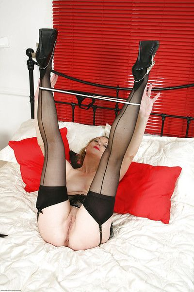Old golden broad Betsy XXX poses down bedroom wearing lingerie and stockings