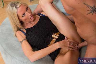 Emma Starr is a hot cougar who decides to fuck a younger guy and she loves his thick cock.