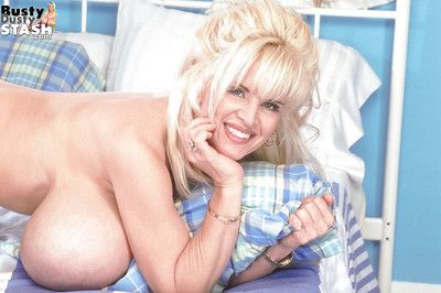 Old flaxen-haired big tit model Busty Past one