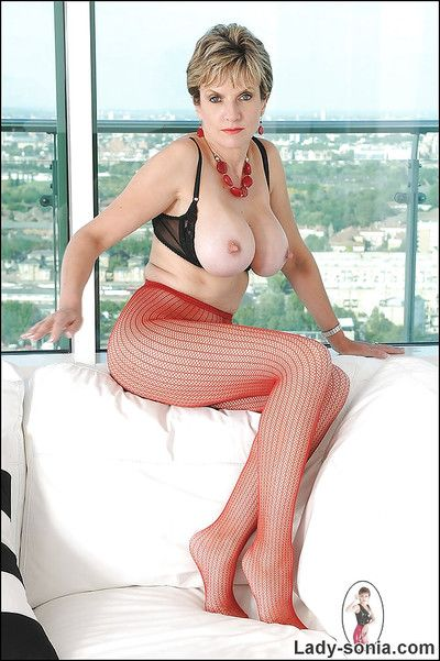 Fuckable mature tot in red pantyhose exposing her big round tits