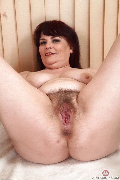 Big mature lady Christina X undresses of hairy cunt manifestation