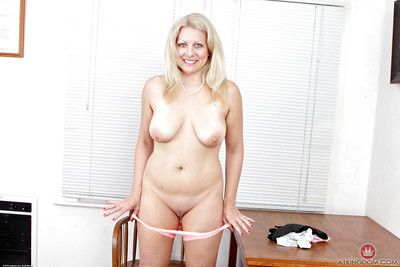 Doyenne blonde partition Zoey Tyler undresses for nude pics be useful to shaved cunt