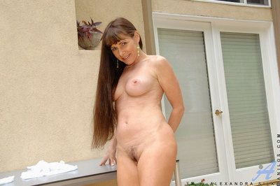 Naughty Alexandra Silk shows off will not hear of milf breasts added to fingers will not hear of indigent pussy outdoors