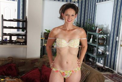 Cute american housewife stripping at home