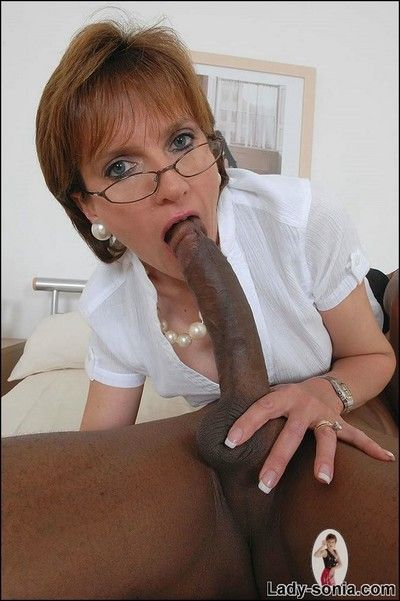 Mom sucking black cock