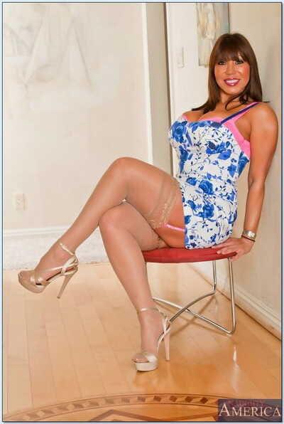 Mature asian charmer Ava Devine posing go-go in nylon stockings