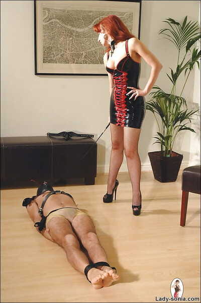 Defamatory redhead femdom in stockings treating her circumscribe non-spiritual pet