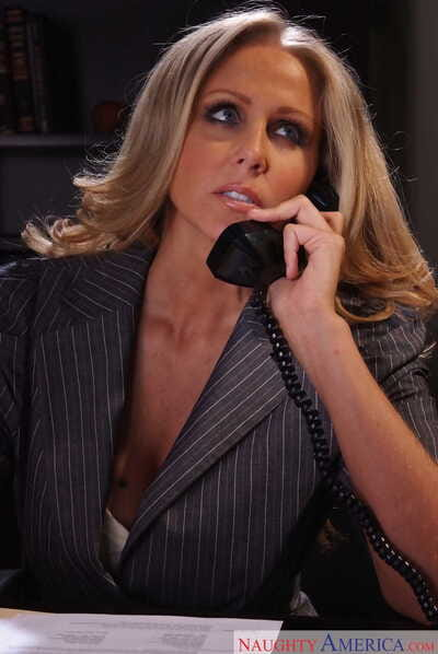 Tow-haired businesswoman Julia Ann strips naked all through their way rendezvous writing-desk
