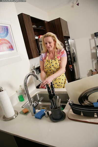 Well-endowed adult unsparing Shasha parting labia idle talk on every side kitchen after stripping