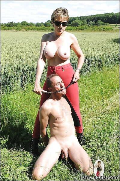 Matured femdom tortures her manslaves cock together with slobber with her high heels