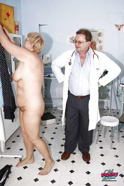 Fatty full-grown lady relating to glasses gets her pussy examed by gyno
