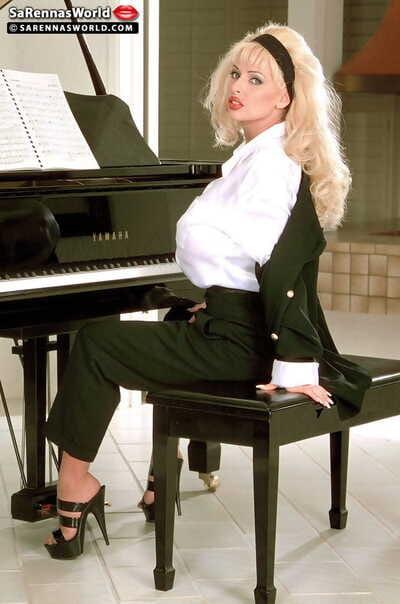 Top mature pornstar SaRenna Lee exposes illustrious bosom on piano bench