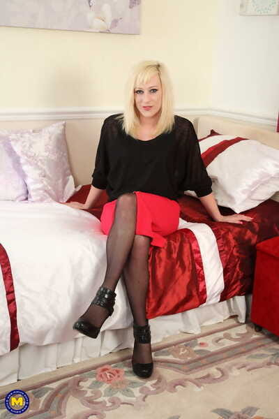 Fair-haired grown-up Axa Jay removes will not hear of red skirt and masturbates anent lingerie