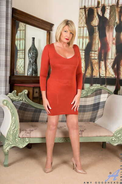 Stunning mature Amy Goodhead removes her in flames dress with an increment of showcases her curvings